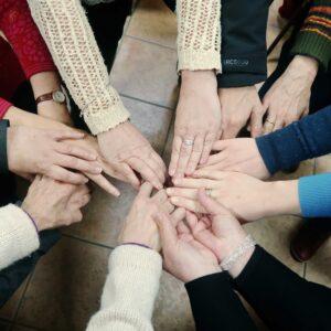 circle of women's hands